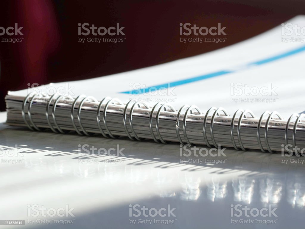 Open spiral notebook stock photo