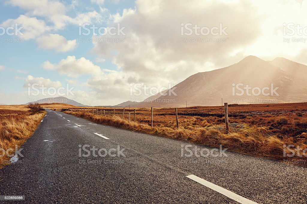 Open Street trough Fields and Mountains stock photo