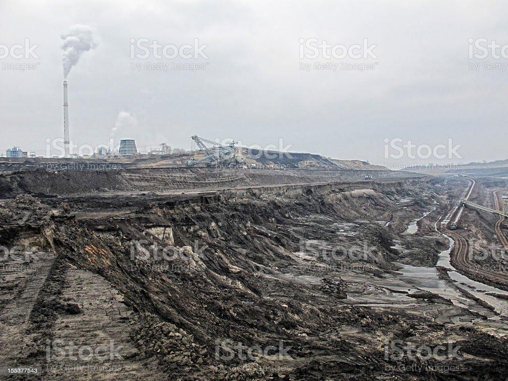 open Strip Coal mine with smoke stake fumes stock photo