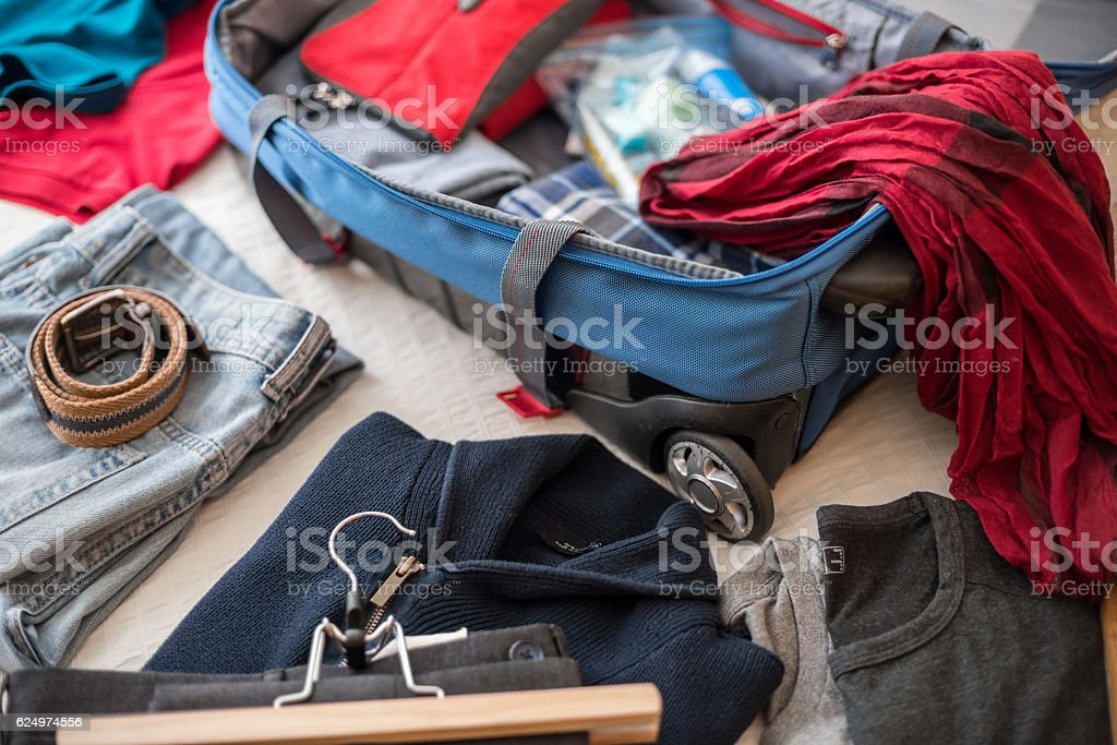 Open suitcase on bed. stock photo