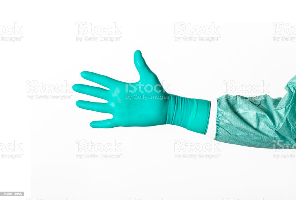 Open surgeons hand in a green latex surgical glove on white background stock photo