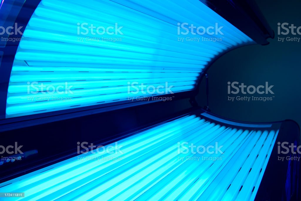 Open tanning bed with the lights on  stock photo