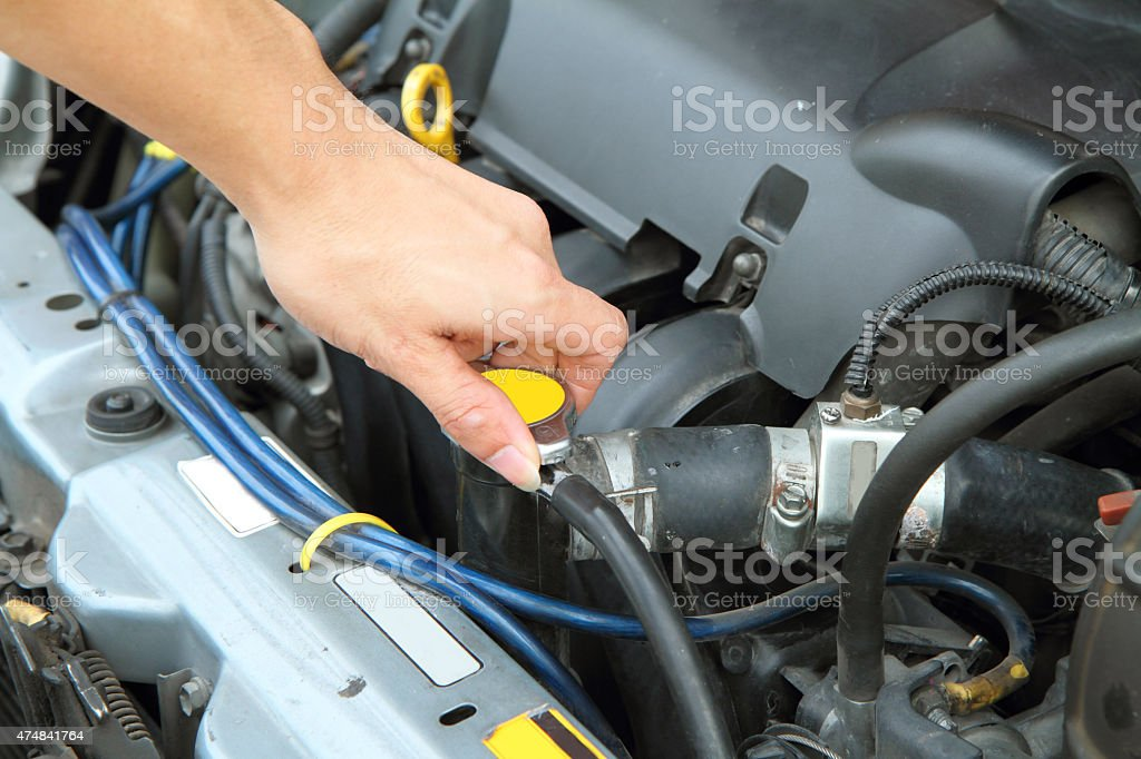 open the car radiator valve stock photo