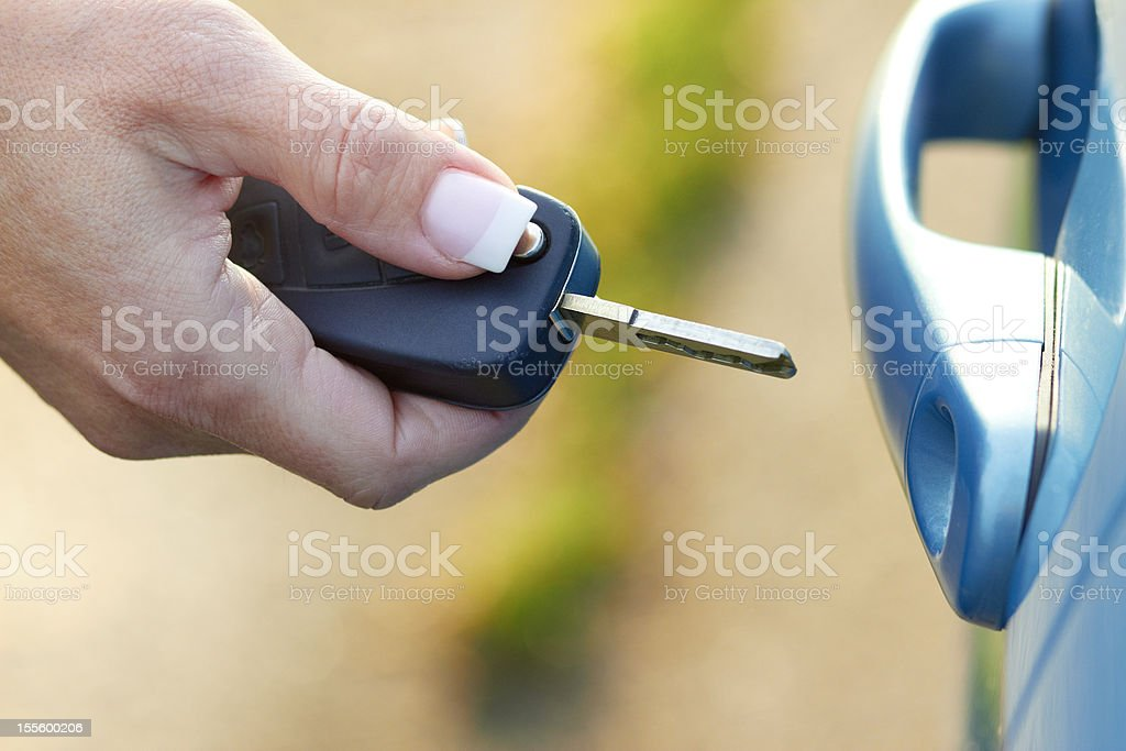 open the car - woman hand with car key stock photo