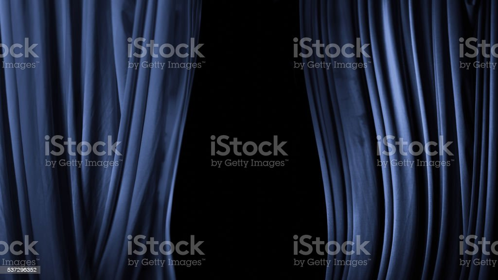 Open the wings of the theater of the blue fabric stock photo