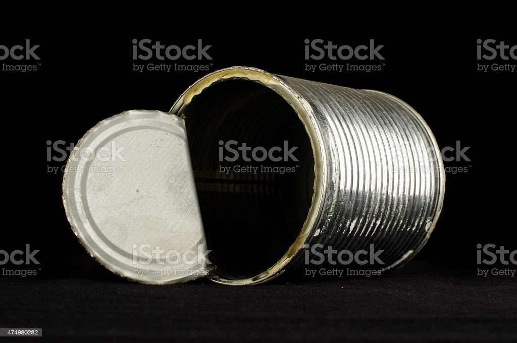 Open tin can isolated on the black background stock photo