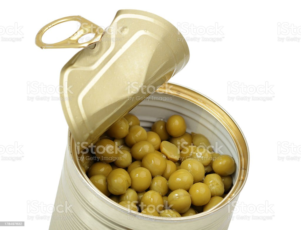 Open tin can with Green Pea royalty-free stock photo