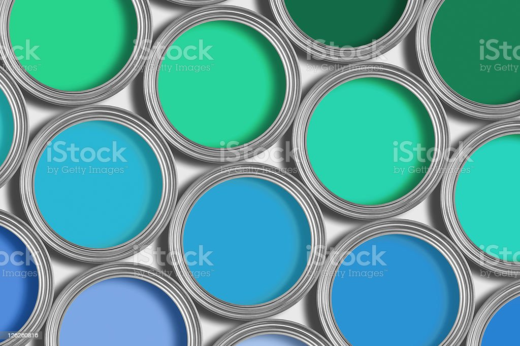 Open tins of blue and green paint on white royalty-free stock photo