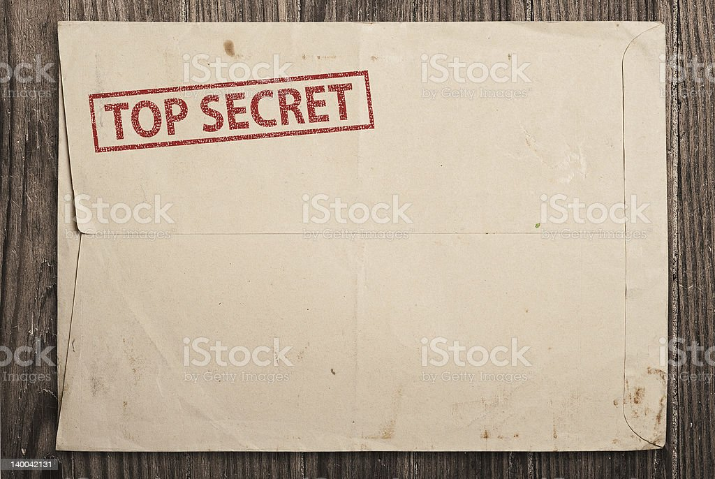 Open top secret envelope on table. stock photo
