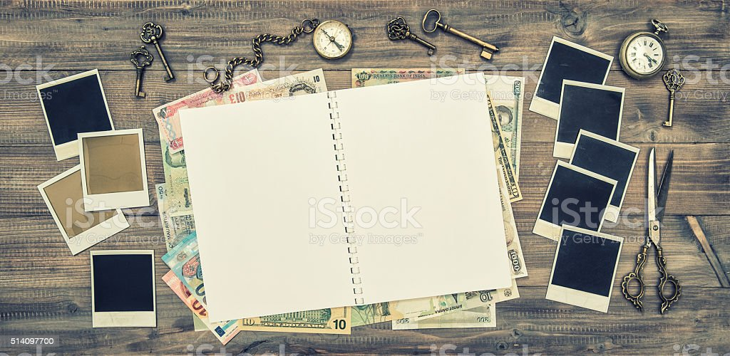 Open travel journal, polaroid photo frames, cash money vintage stock photo
