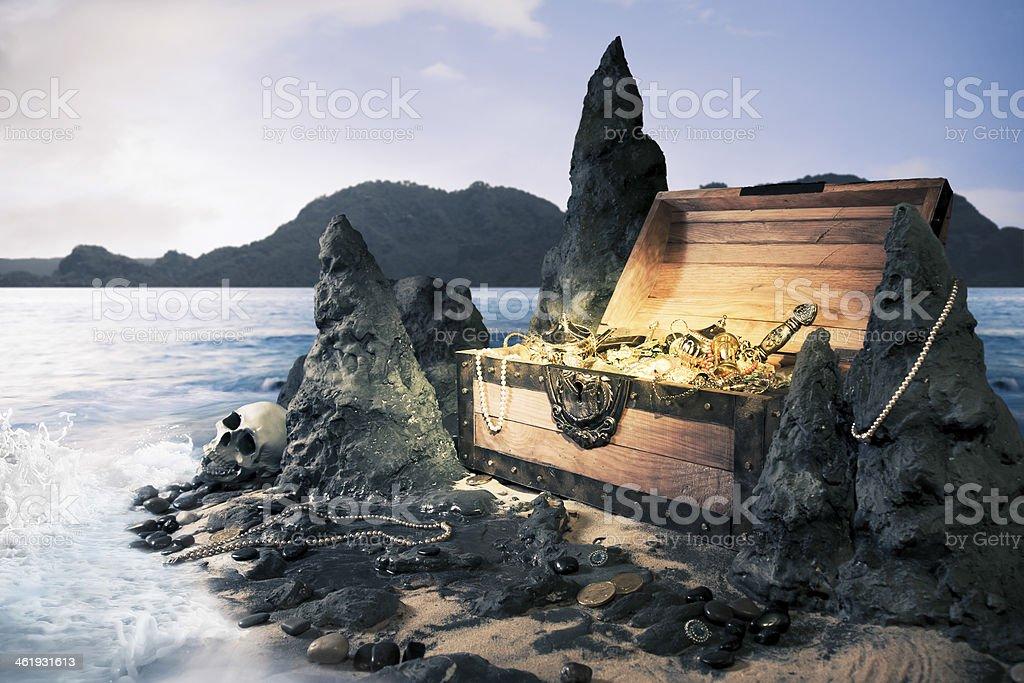 Open treasure chest at the beach stock photo