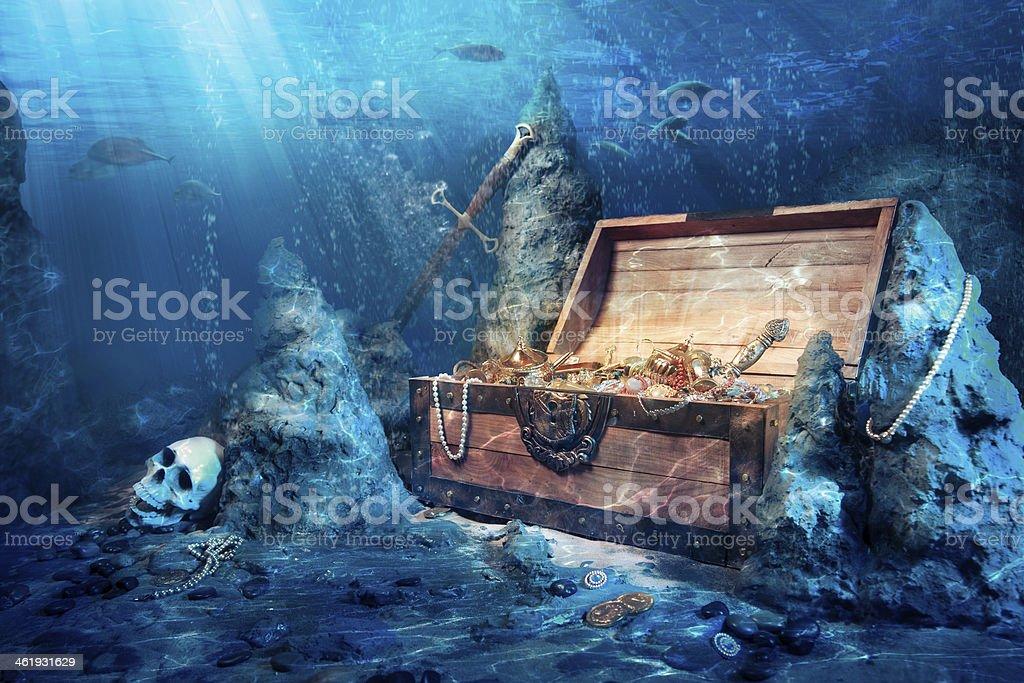 Open treasure chest underwater stock photo