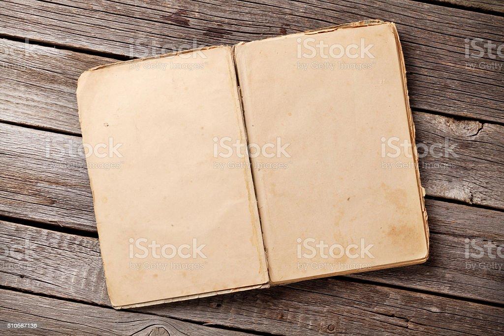 Open vintage book on wood stock photo