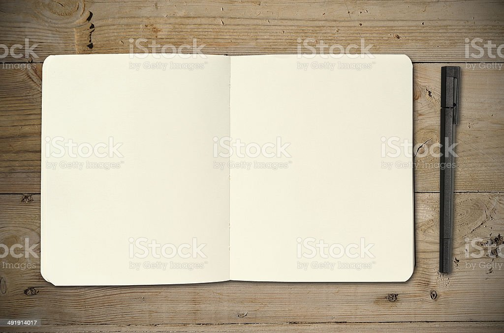Open vintage sketchbook with pencil stock photo