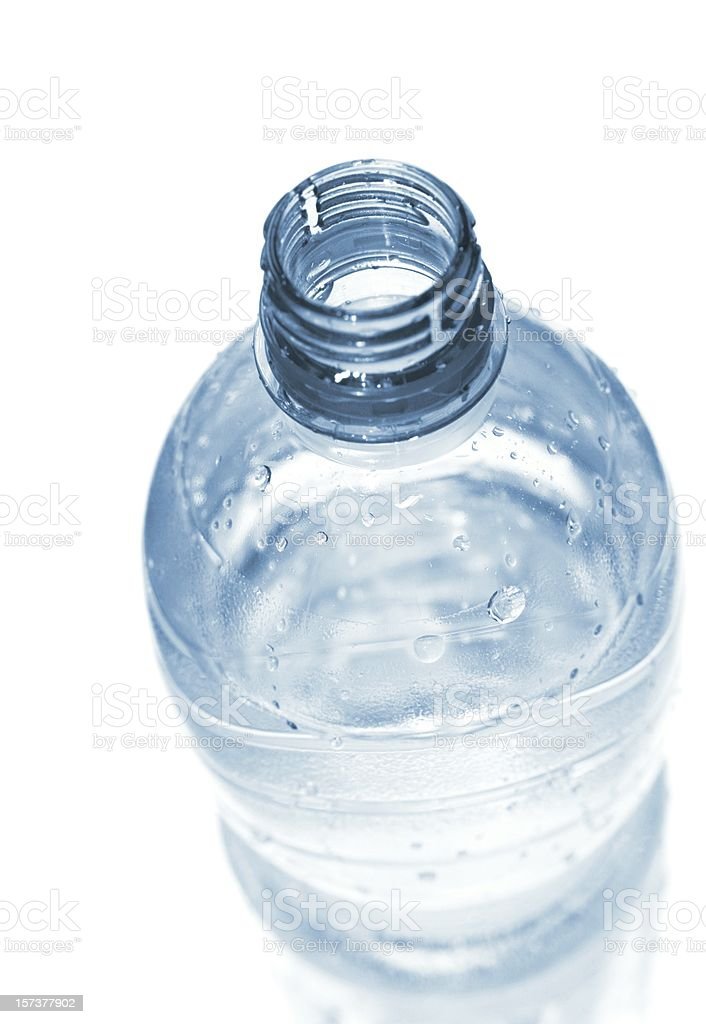 open wet plastic water bottle isolated on white. stock photo
