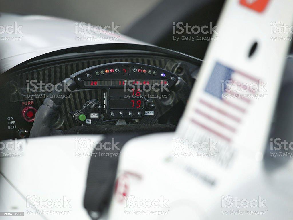 Open wheel racing car steering wheel stock photo