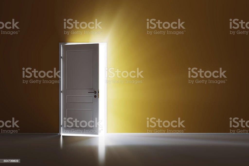 Open white door on orange wall stock photo