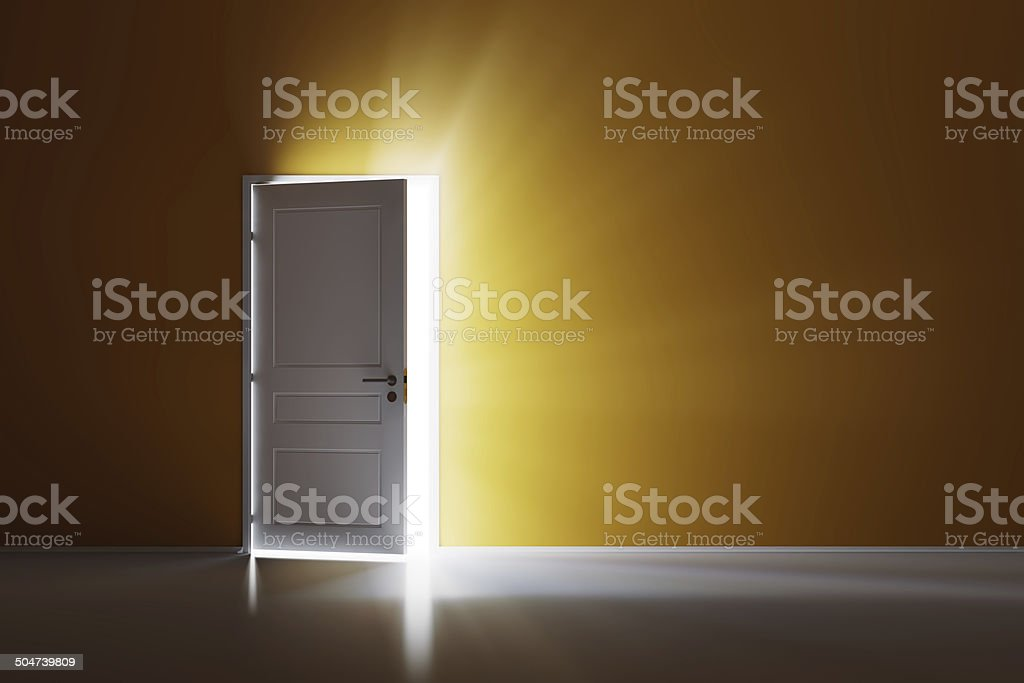 Open white door on orange wall stock photo
