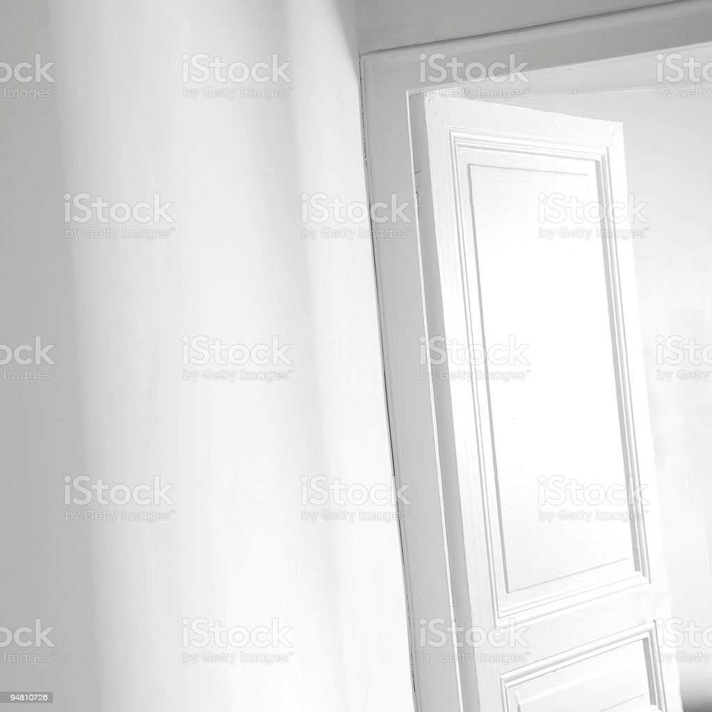 Open white door (b&w) royalty-free stock photo