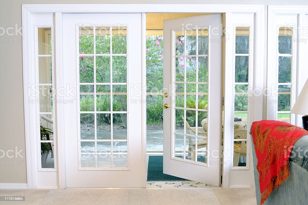 Open White French Doors Without Curtains stock photo