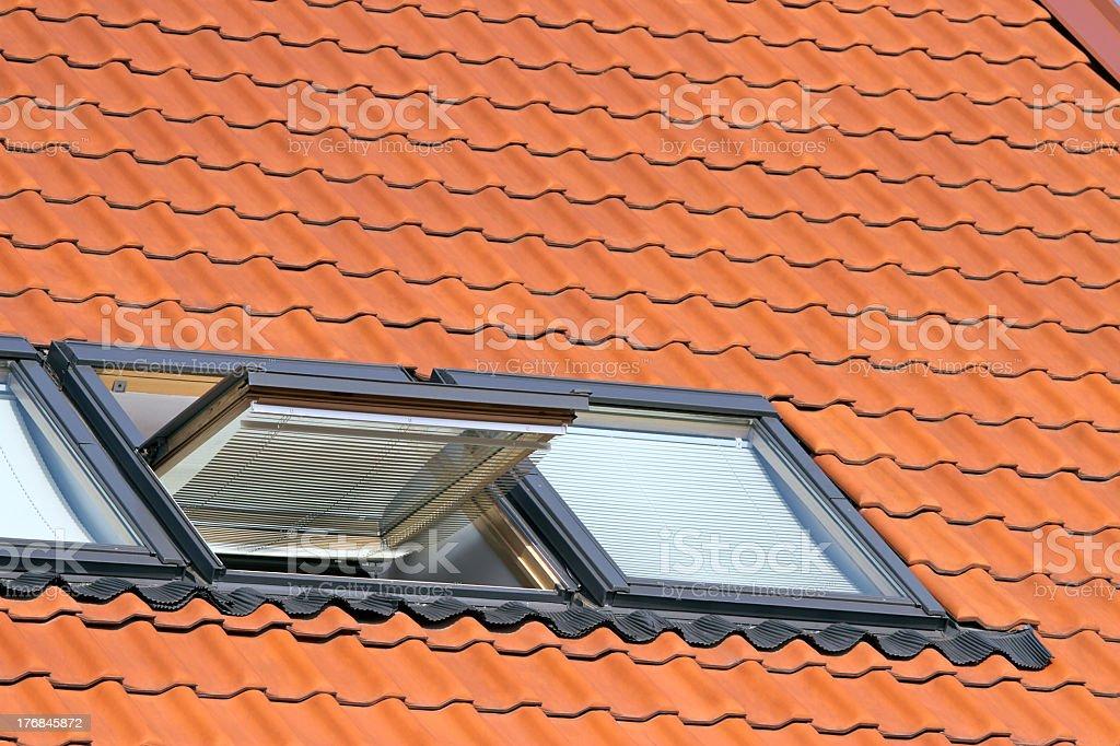 Open window on a terra cotta dormer roof stock photo
