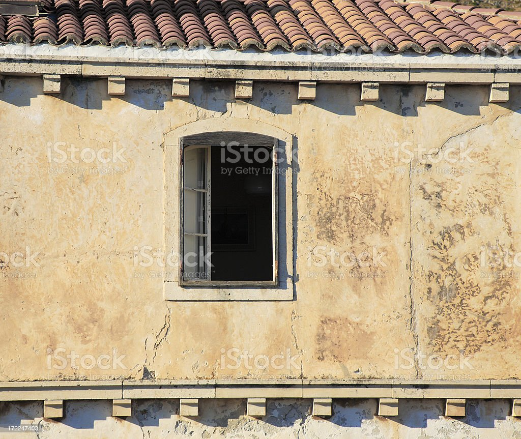 Open window, red roof tiles. royalty-free stock photo