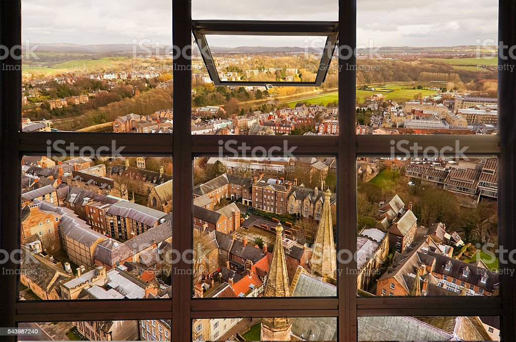 Open window to see top view of Durham city. stock photo