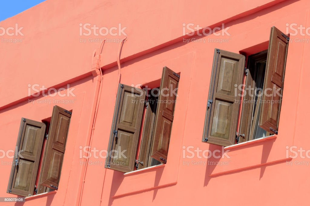Open windows with wooden shutters stock photo