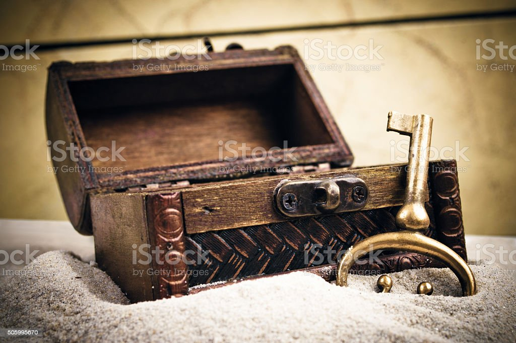 Open wooden chest and metal key stock photo