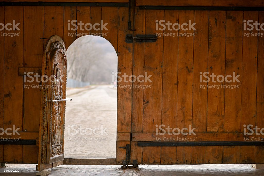 Open wooden door of outside wall and bokeh stock photo