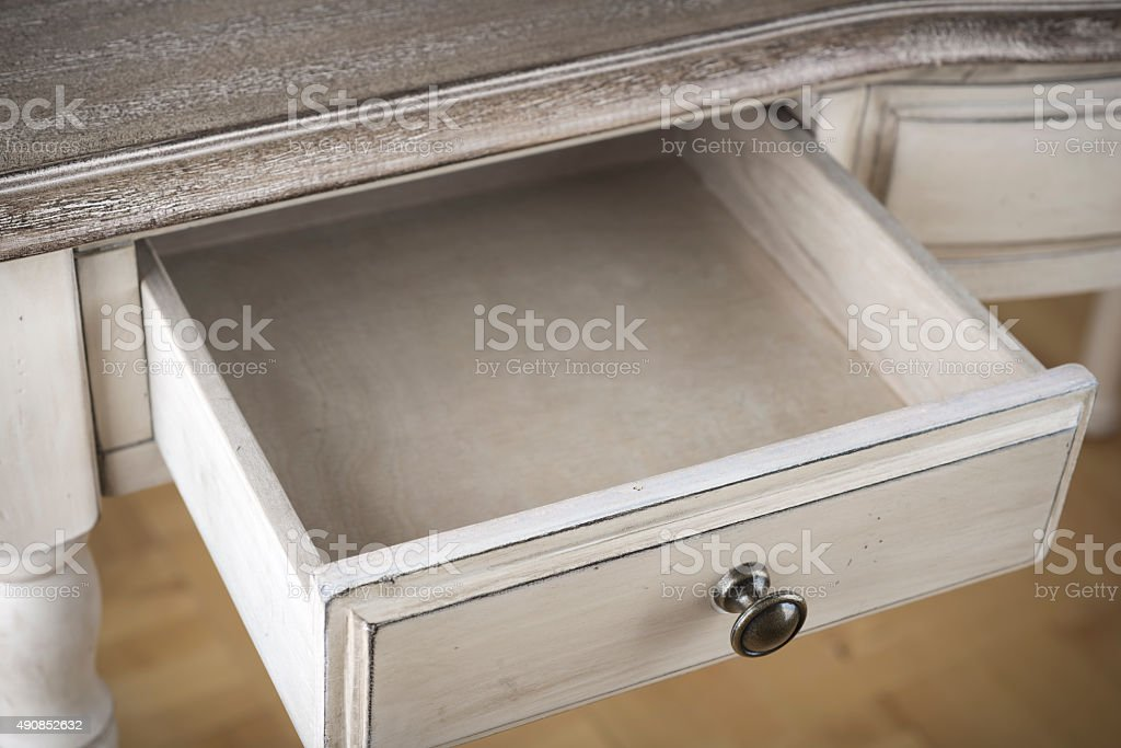 Open wooden drawer of vintage writting table stock photo