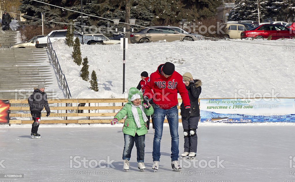 Open-air ice rink. 2 stock photo
