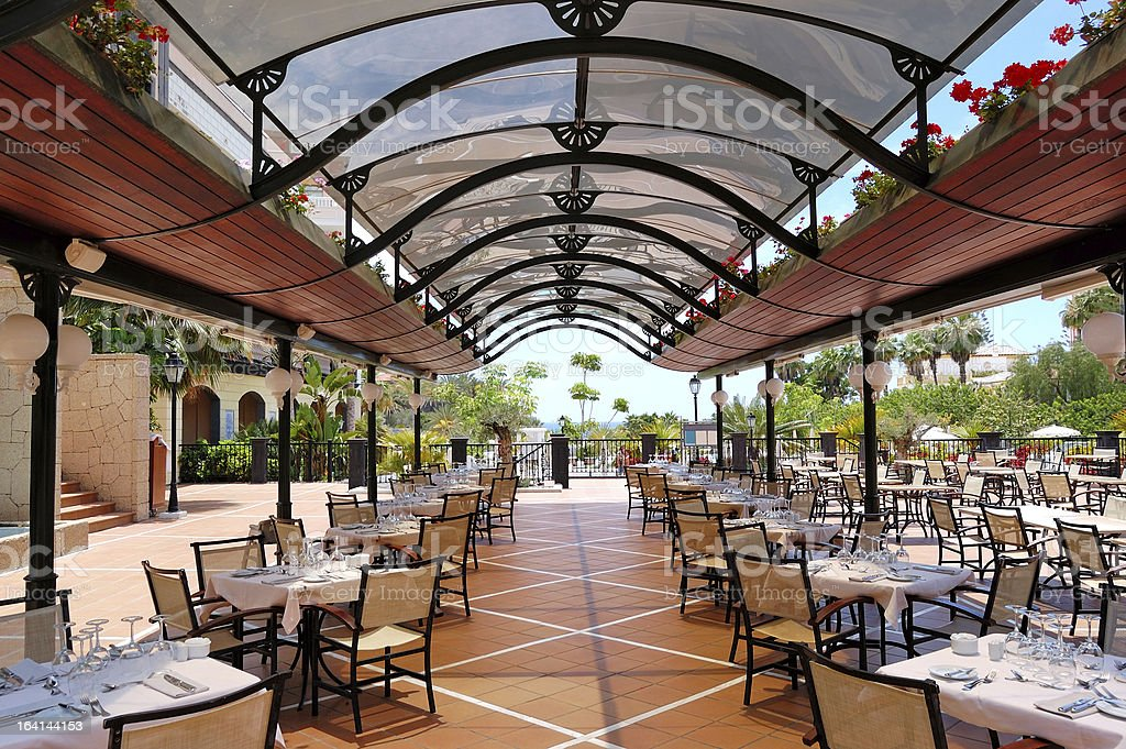 Open-air restaurant at luxury hotel, Tenerife island, Spain royalty-free stock photo