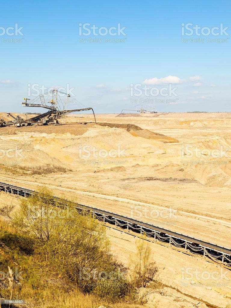 Opencast brown coal mine. Belt conveyor. stock photo