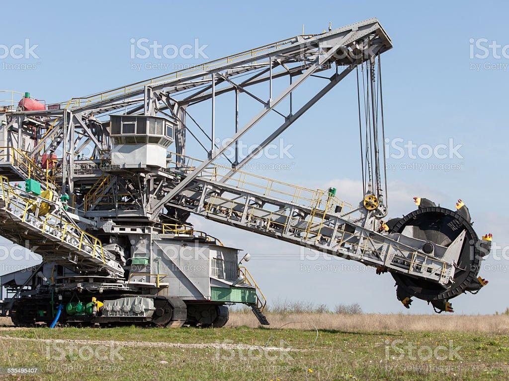 Opencast brown coal mine. Bucket wheel excavator. stock photo