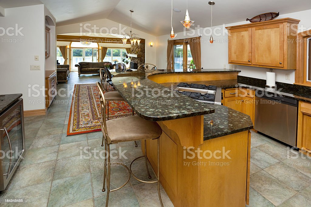 Open-Concept Kitchen With Granite Counters, Adjoining Dining Room royalty-free stock photo