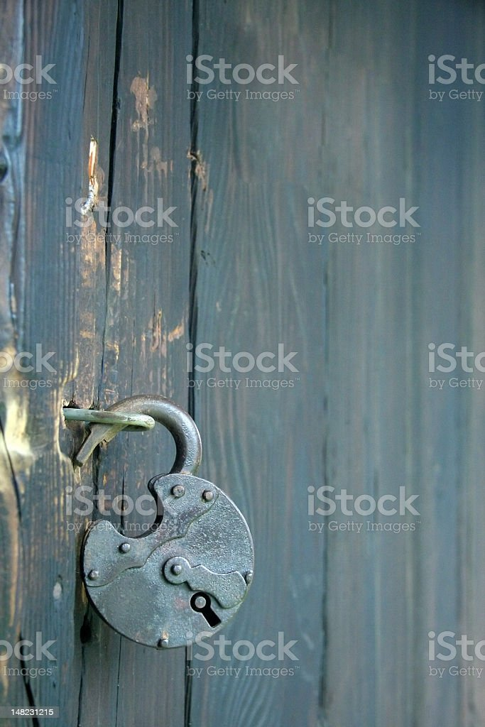 Opened and unlocked lock on a wood door stock photo