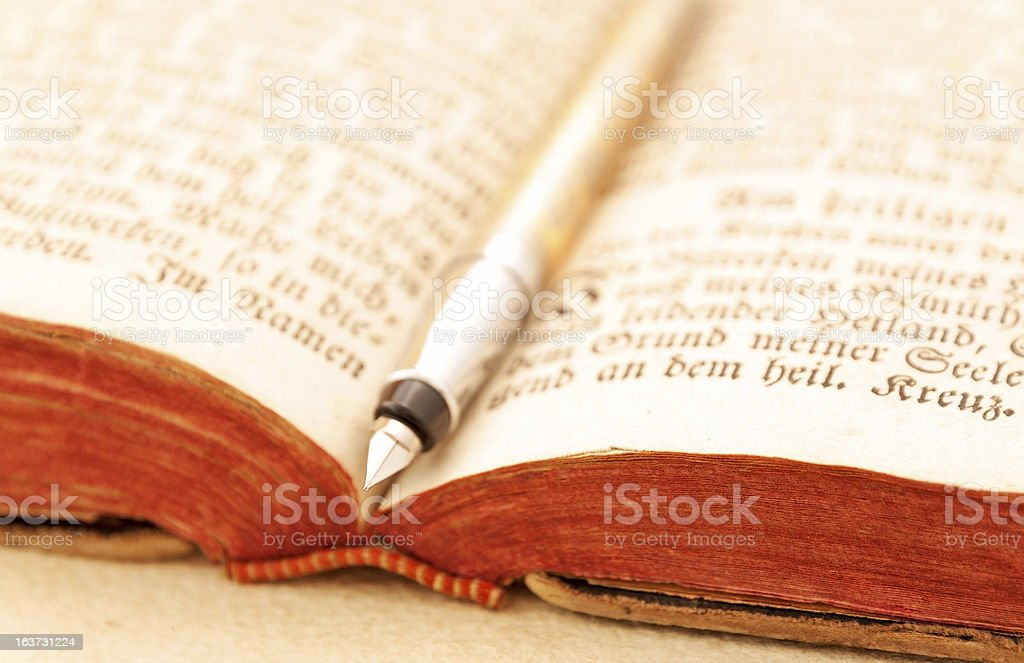 Opened antique book with fountain pen royalty-free stock photo