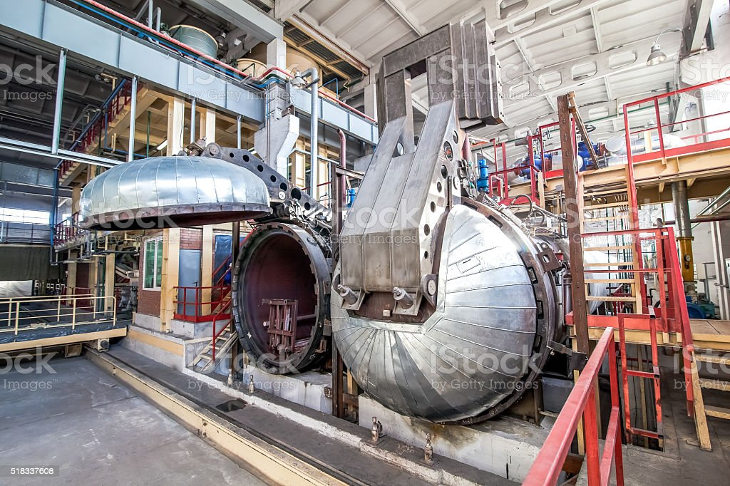 opened autoclave for concrete blocks production at factory stock photo