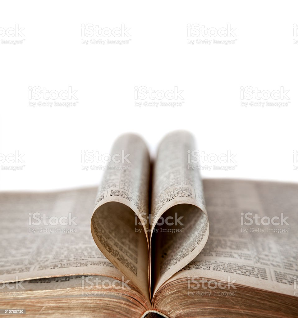 Opened Bible With Heart Shape and Copy Space stock photo