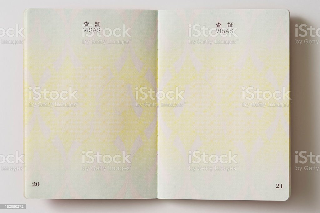 Opened blank Japanese Passport on white background stock photo