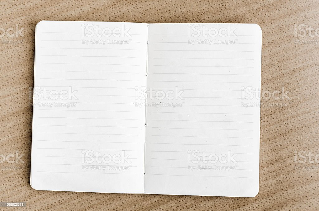 Opened blank notebook on wooden table stock photo