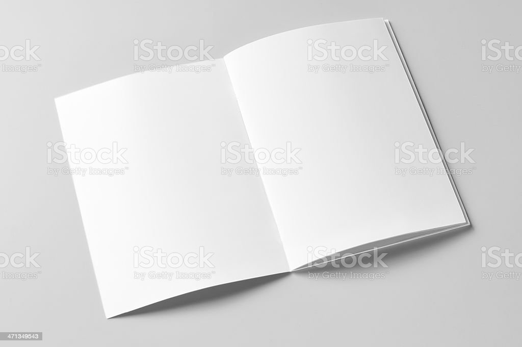 Opened blank white brochure on a white background stock photo