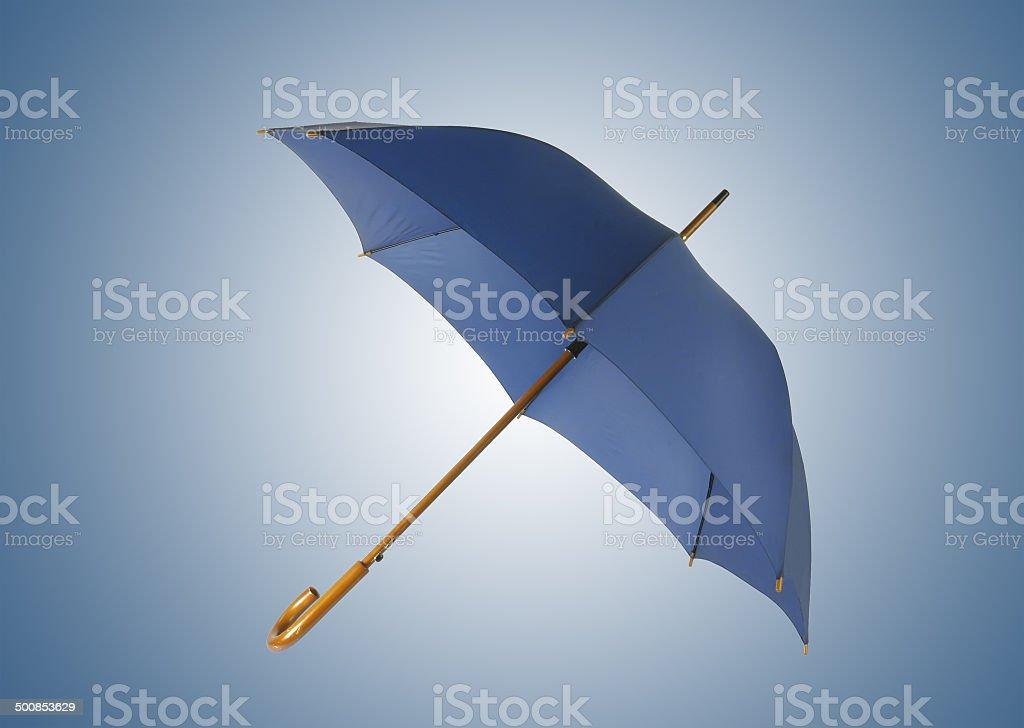 Opened blue umbrella isolated on white background stock photo
