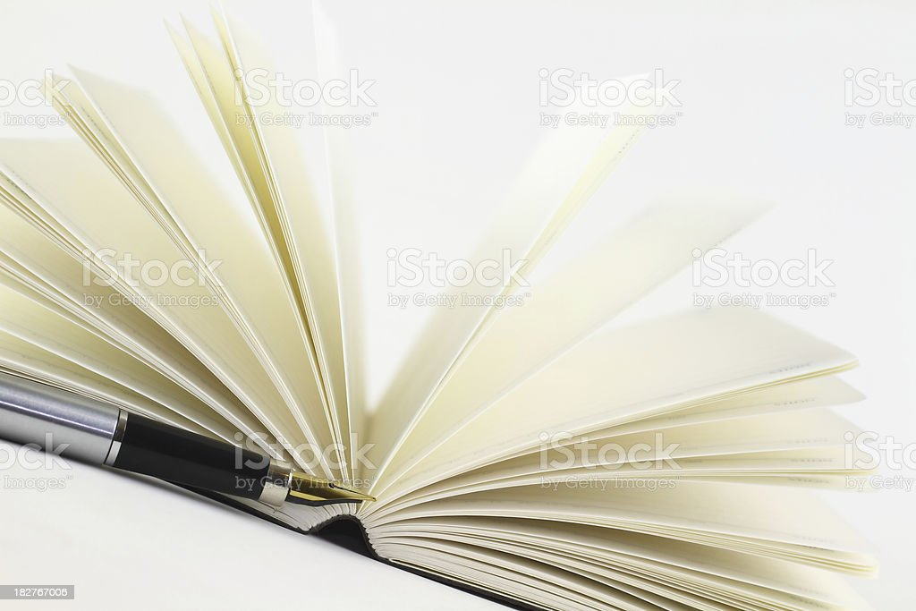 Opened book and fountain pen stock photo