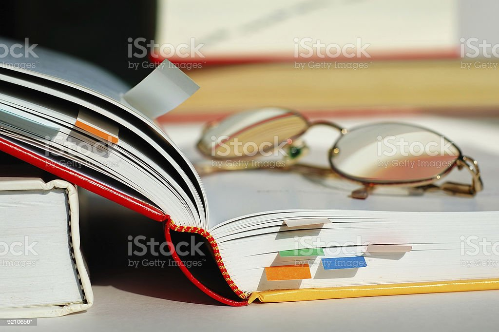 Opened book and glasses stock photo