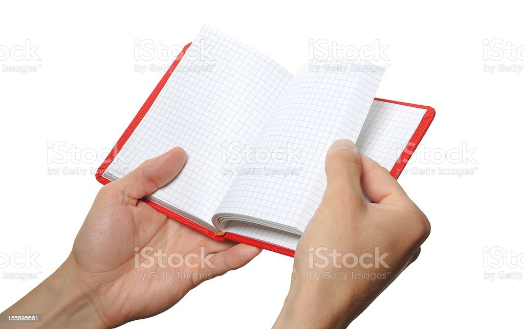 opened book in hand royalty-free stock photo