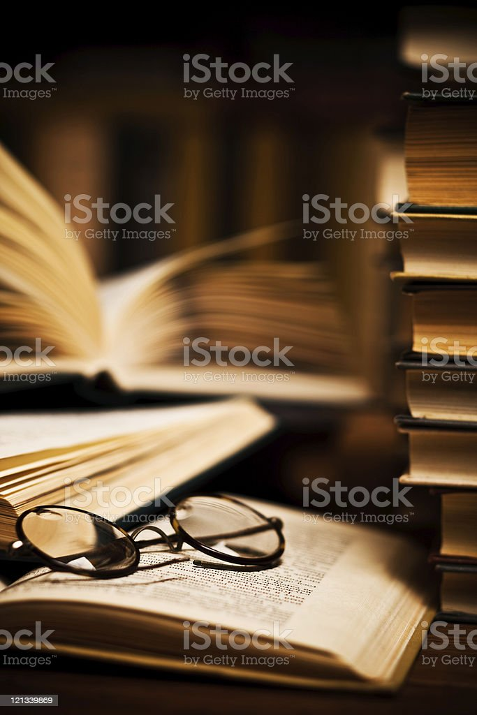 opened book, lying on the bookshelf stock photo