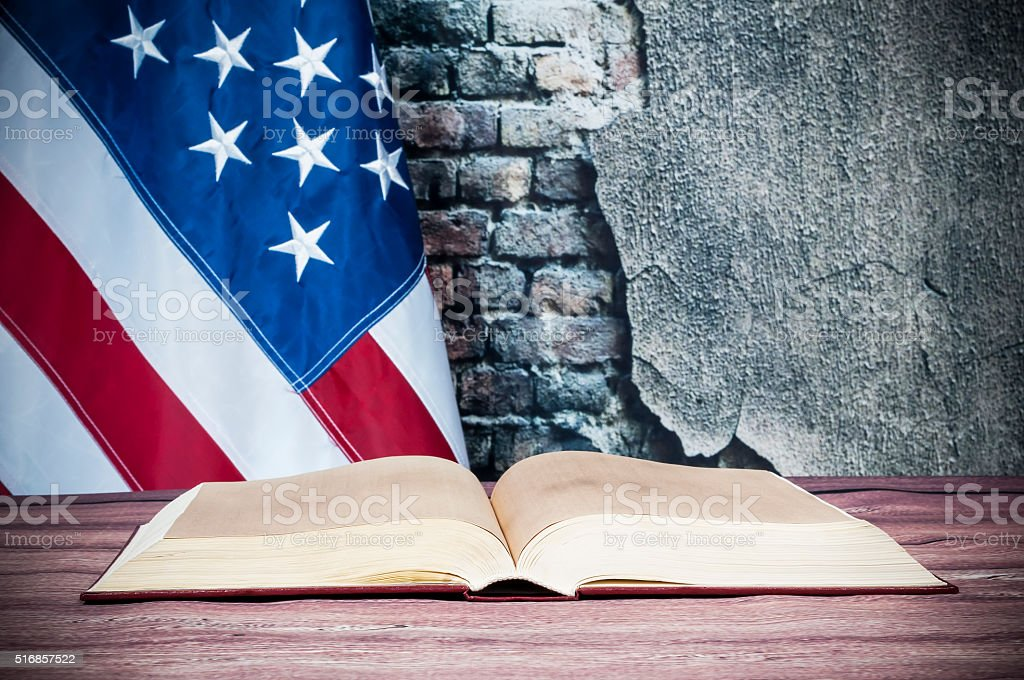 Opened book on a background of the USA flag stock photo
