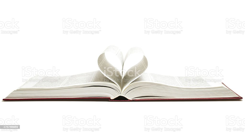 Opened book with heart stock photo